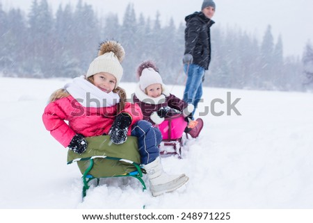 Happy family in winter outdoors - stock photo