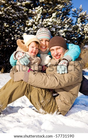 Happy family in winter park - stock photo