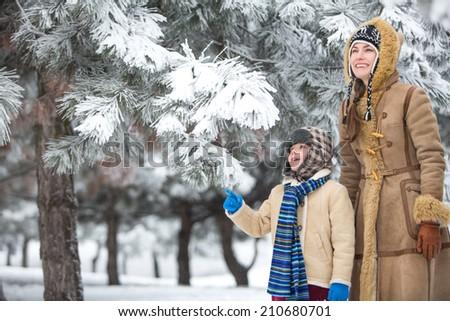 Happy family in winter park having fun. copy space - stock photo