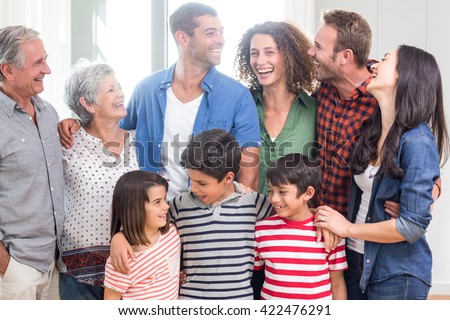 Happy family interacting with each other at home - stock photo