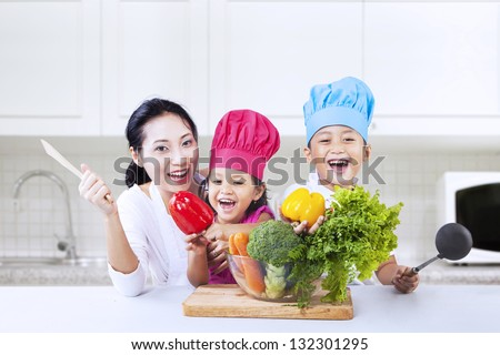 Happy family is cooking in the kitchen together - stock photo