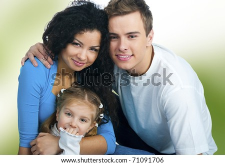 Happy family isolated on a green  background - stock photo