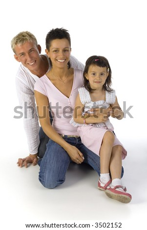 Happy family kneeling on the floor. Looking at camera, front view. White background - stock photo