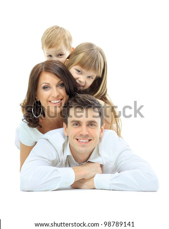 Happy family laying - stock photo