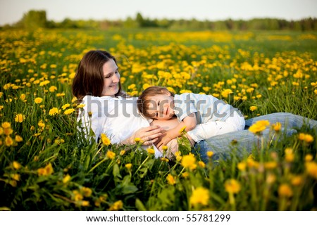 happy family: little son listening stomach of his pregnant mother - stock photo