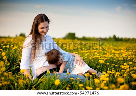 happy family: little son stroking stomach of his pregnant mother - stock photo