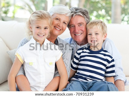 Happy family looking at the camera - stock photo