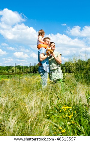 Happy family looking to the future - stock photo