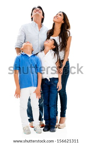 Happy family looking up - isolated over a white background  - stock photo