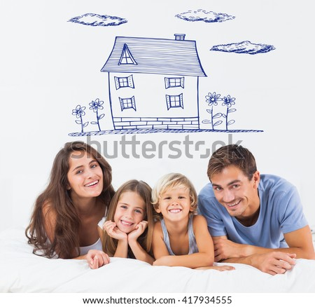 Happy family lying on a bed against hand drawn house - stock photo