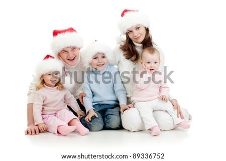 happy family lying on floor in studio isolated on white - stock photo