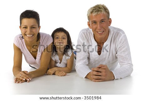 Happy family lying on the floor. Looking at camera. White backgroung, front view - stock photo