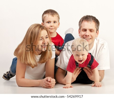 Happy family lying on White Background - stock photo