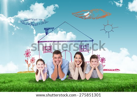 Happy family lying with head in hands against blue sky over green field