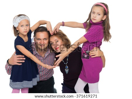 happy family makes the heart - stock photo