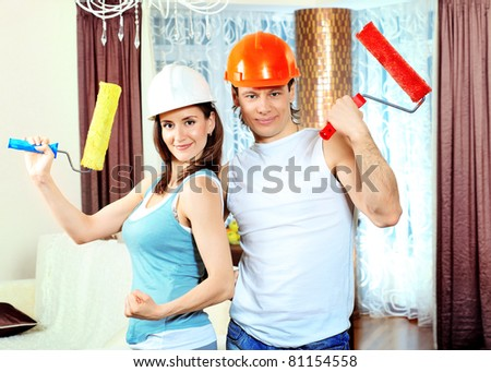 Happy family making repairs at their new home. - stock photo