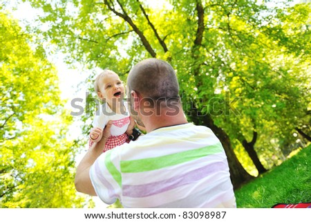happy family man and baby children playing in bright park while representing happines and parenthood concept - stock photo