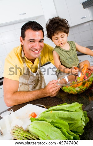 happy family man cooking food together with his toddler son