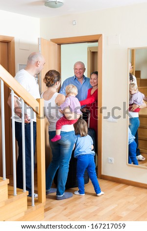Happy family meeting kinsfolks at home - stock photo