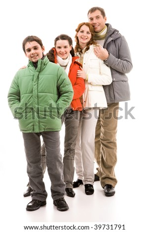 Happy family members in warm jackets over white background - stock photo