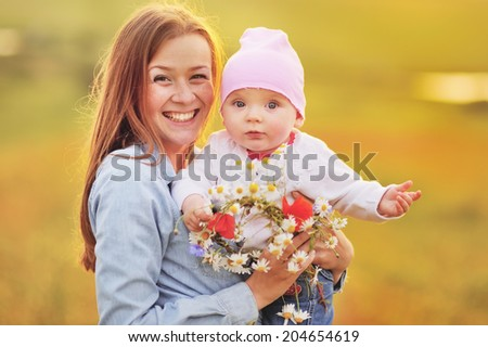 Happy family, mom and lovely daughter. Sunny summer weather. - stock photo