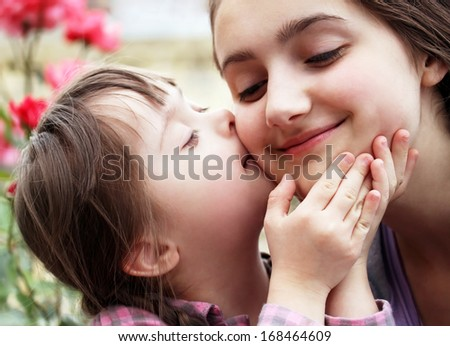 Happy family moments - Mother and child have a fun. - stock photo