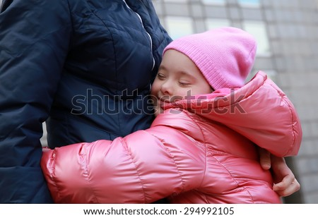 Happy family moments - Mother and child having fun in the city - stock photo