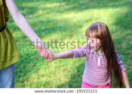 Happy family moments - Mother and child in the park. - stock photo