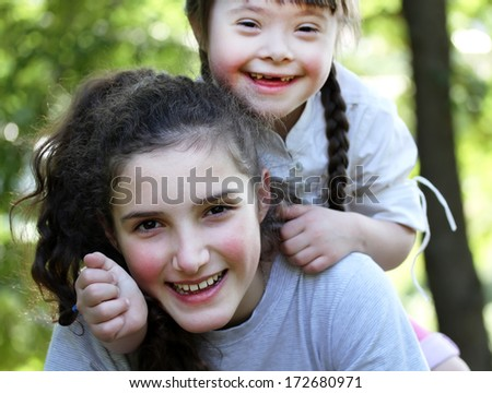 Happy family moments - sisters have a fun. - stock photo