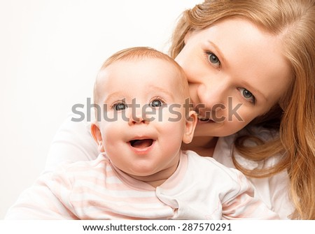 happy family mother and baby daughter hugging and enjoy life - stock photo