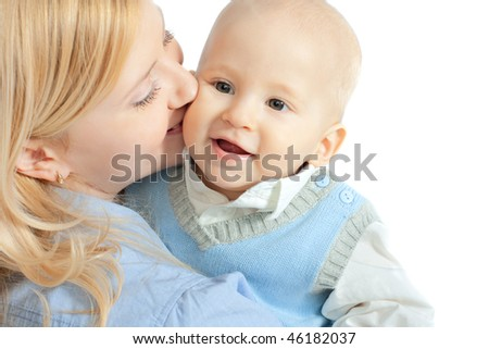 happy family: mother and baby kissing and smiling - stock photo