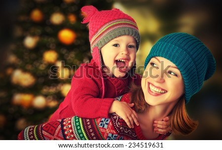 happy family mother and baby little daughter playing in the winter for the Christmas holidays - stock photo
