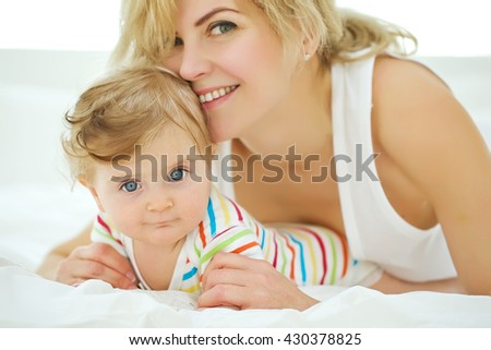 happy family. Mother and baby playing and smiling  - stock photo
