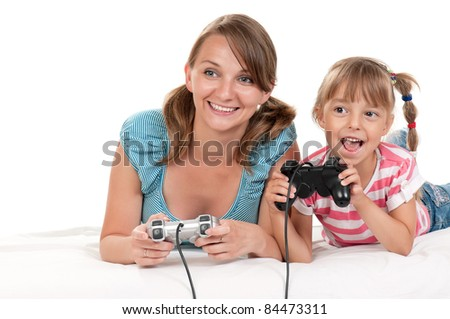 Happy family - mother and child playing a video game - stock photo