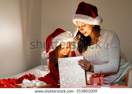 Happy family. Mother and daughter with magic gift box