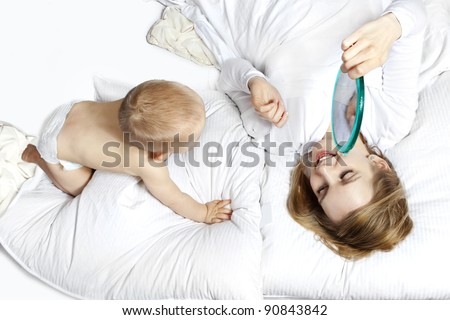 happy family, mother and her baby at the blanket on the bed at home. Baby give kiss