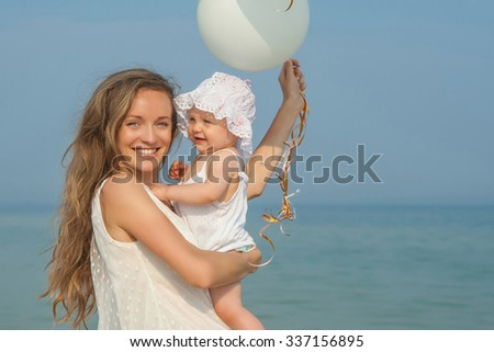 Happy family. Mother and her daughter having fun on the beach. Positive human emotions, feelings. - stock photo