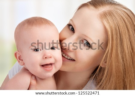happy family. mother and little baby - stock photo