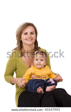 Happy family. Mother and little daughter are smiling . Woman and baby are hugging and posing happily on white background