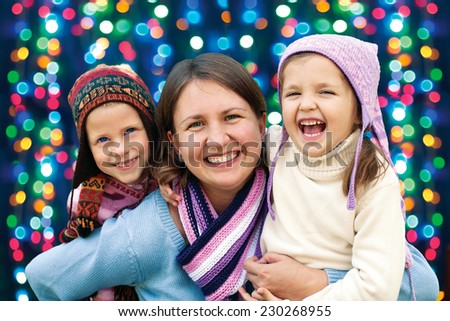 happy family mother and two little daughter playing in the winter for the Christmas holidays  - stock photo