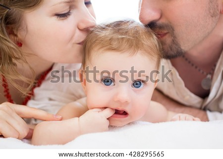 Happy family, mother, father aand little baby - stock photo