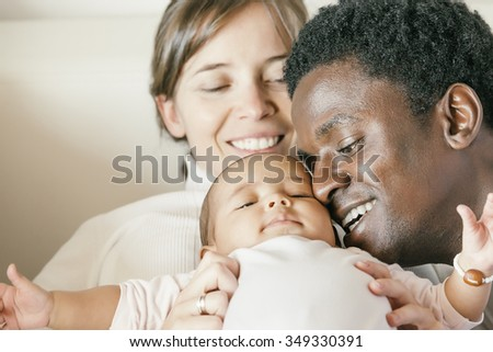 Happy Family, Mother, Father And Baby on Bed - stock photo