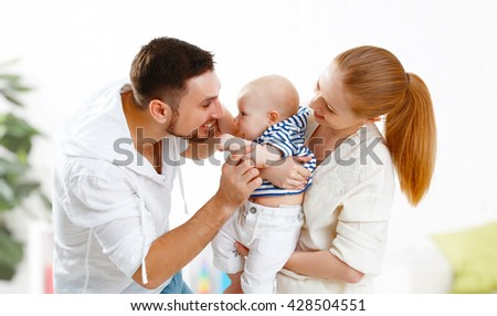 happy family mother, father and son, child baby at home - stock photo