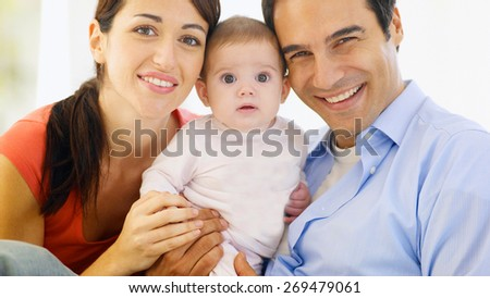 happy family, mother ,father and their baby