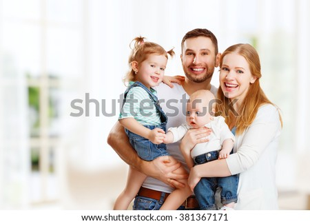 happy family mother, father and two children at home
