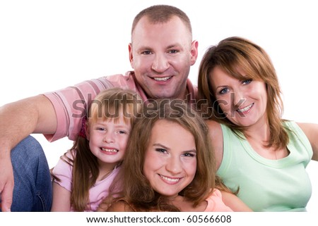 Happy family. Mother, father and two daughters - stock photo