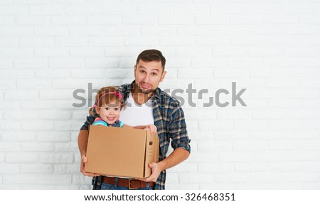 happy family moves to new apartment. dad and child  daughter playing  and have fun packs in cardboard boxes - stock photo