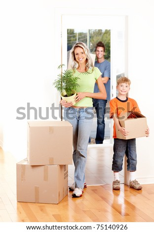 Happy family moving into their new home - stock photo