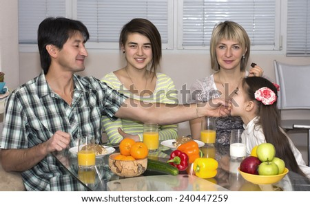 Happy family. Multinational family eating vegetarian lunch. - stock photo