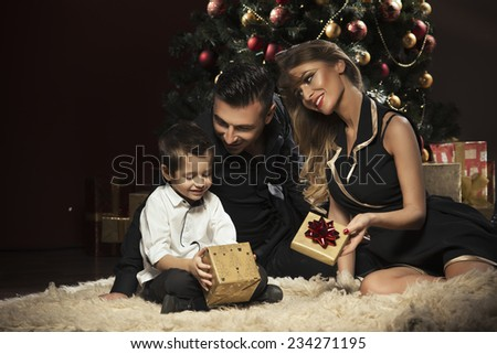 Happy family near Christmas tree